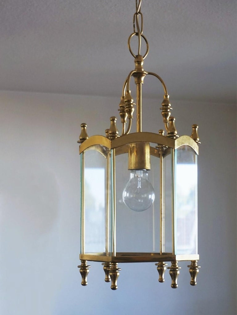 A vintage hexagonal brass and clear glass lantern with a simple design, Italy, 1950-1960. One brass and ceramic E27 light socket for a 60w-100w bulb - rewired and ready to hang. Dimensions: Total height 30