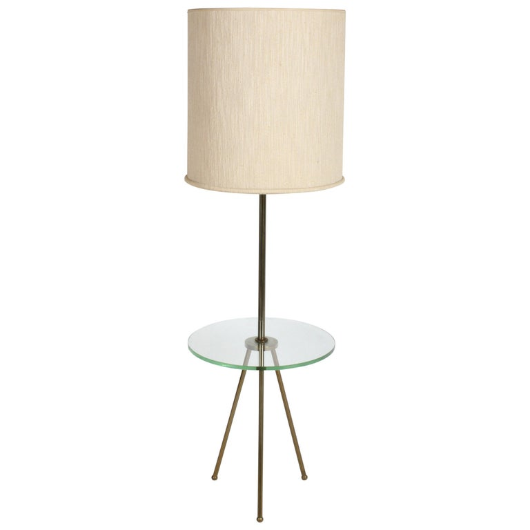Mid-Century Modern Italian Brass Floor Lamp with Tripod Legs and Glass Shelf For Sale