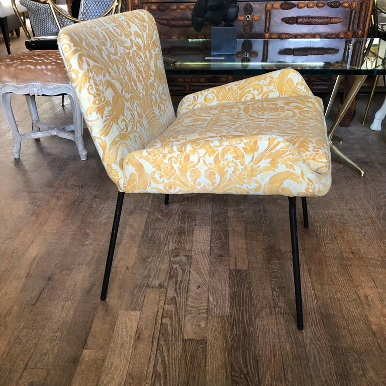 Whimsical midcentury Italian chair newly upholstered in a cheery and sophisticated yellow Fortuny cotton. It has an iron frame.