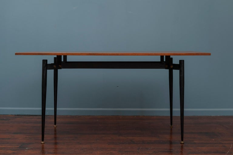 Mid-Century Modern Italian small dining table or desk with an interesting steel framed base and a floating teak top.