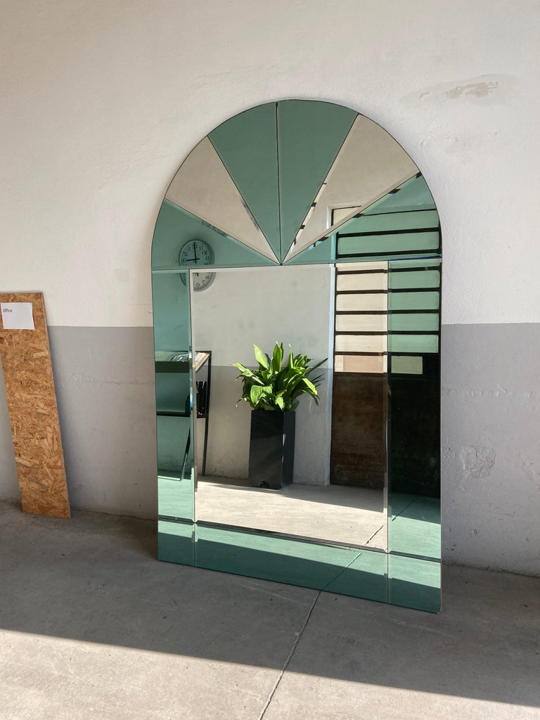 Mid-Century Modern Italian wall mirror with colored mirror inserts, 1970s. The mirror is in real good vintage conditions, it only has a little chip in the lower right part as shown in the photos This mirror could become a set with another one with