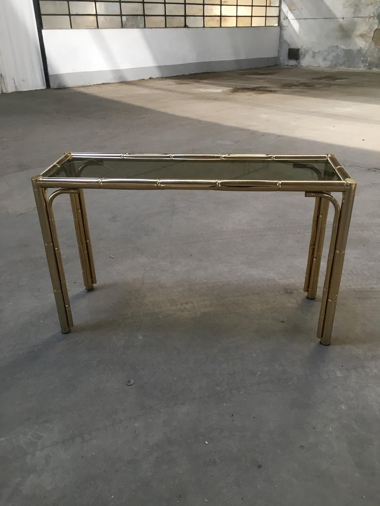 Mid-Century Modern Italian Gilt Faux Bamboo Console with Smoked Glass Top, 1970s In Good Condition For Sale In Prato, IT