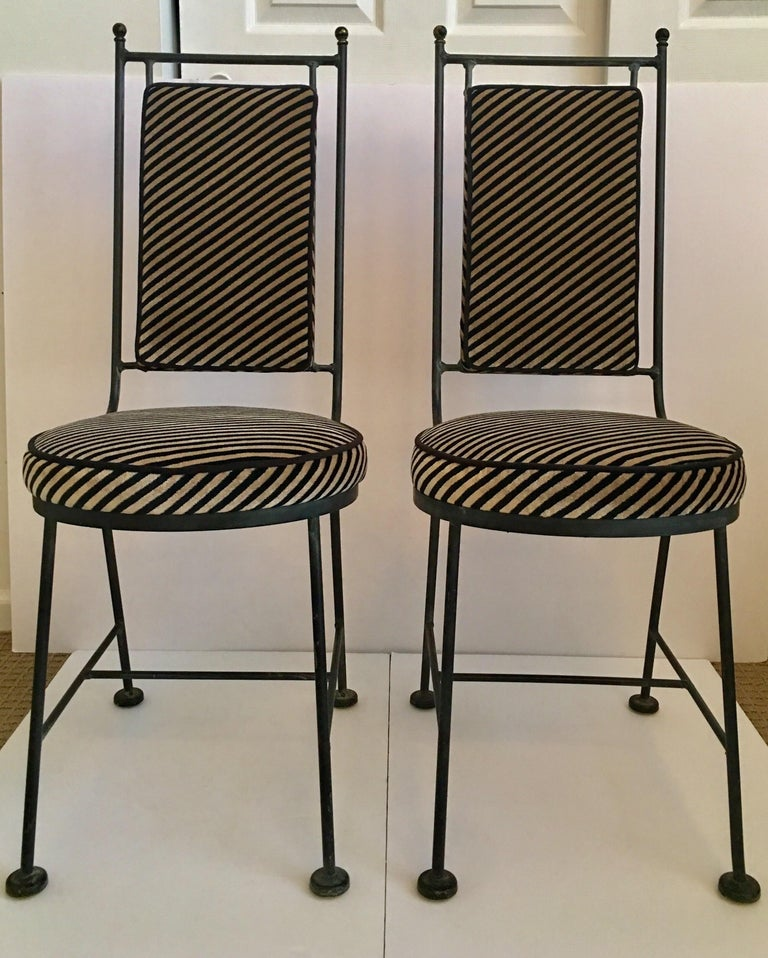 Midcentury Modern black wrought iron Savonarola style chairs custom upholstered in Kelly Wearstler Italian oblique diagonal striped velvet fabric for Groundworks. Newly upholstered geometric memphis style round seat and rectangular box back cushions