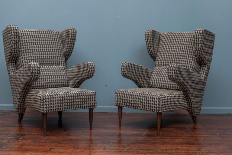 Mid-Century Modern Italian large lounge chairs in very good restored condition.