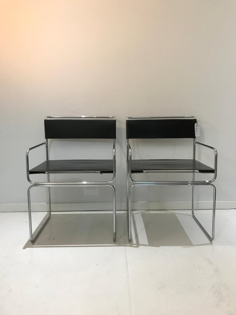 Two vintage Planula design chairs by G. Carini 1970 four leather dining chairs by designer Giovanni Carini and made by Planula Design Italy. These chairs have a chrome-plated tubular steel frame with thick leather and not often seen with armrests!