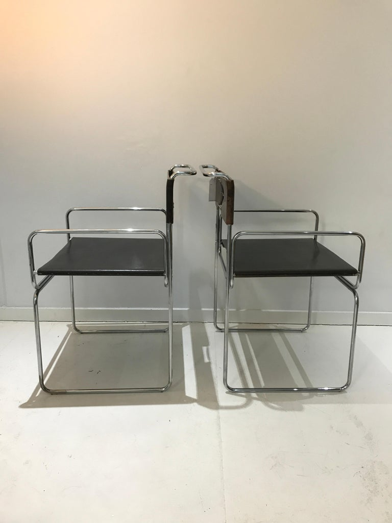 Steel Mid-Century Modern Italian leather chairs by Giovanni Carini for Planula, 1970 For Sale