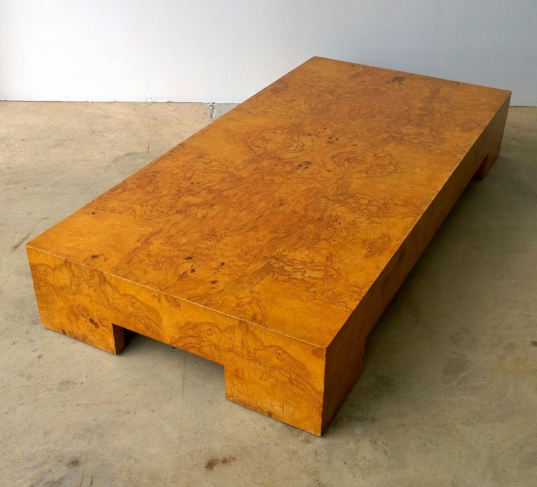 Offered is a Mid-Century Modern Italian Milo Baughman style burl wood veneer coffee / cocktail / low table. This piece is Minimalist in its lines yet quite elegant with the use of the burl wood. This low table was usually produced as a large square
