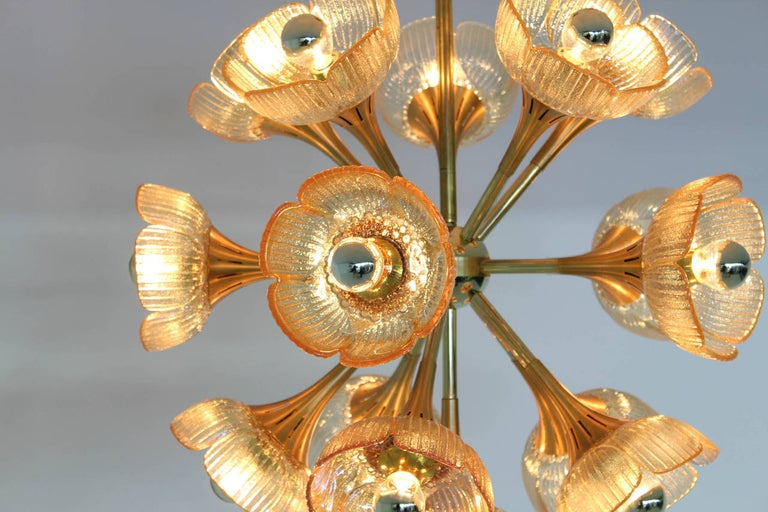Stunning Italian Mid-Century Modern chandelier in the style of Gaetano Sciolari. Brass and gold-plated metal frame with 16 original Murano glass shades. All shades in perfect condition.