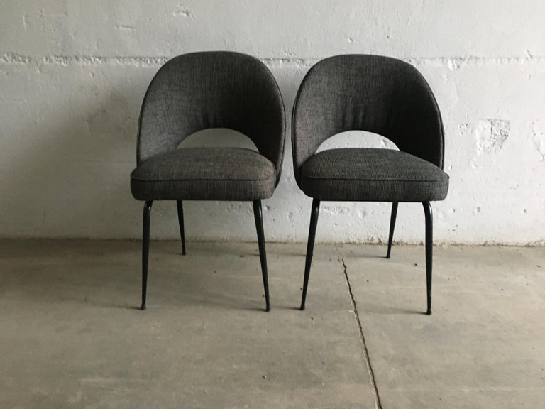 Mid-Century Modern Italian pair of upholstered chairs with black iron legs, 1960s.
