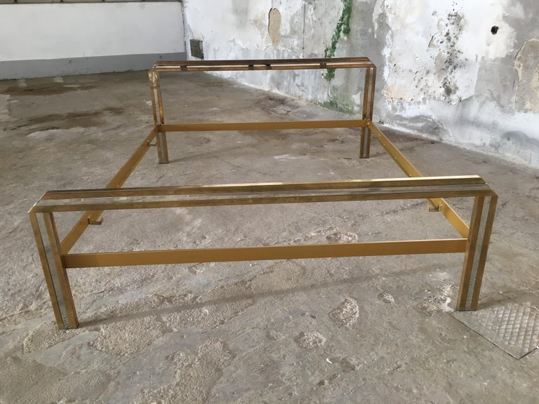 Mid-Century Modern Italian Romeo Rega brass and chrome double bed, 1970s. The bed can come with its bed net (price on demand). The bed needs a mattress of cm. 160 x 190.