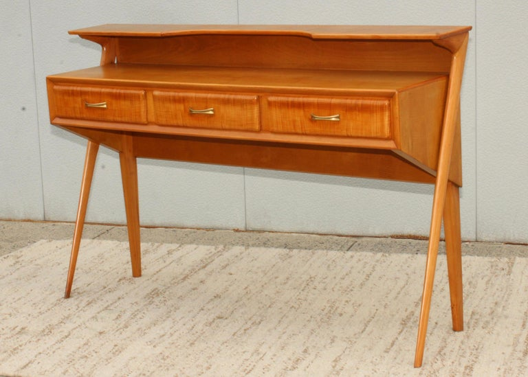 Stunning 1950s cherrywood sculptural Italian two tier console, in vintage condition lightly restored with some wear and patina.