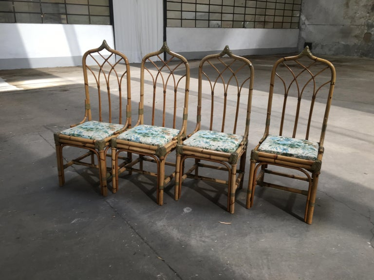 Mid-Century Modern set of 4 bamboo Italian chairs with original floral cushions.