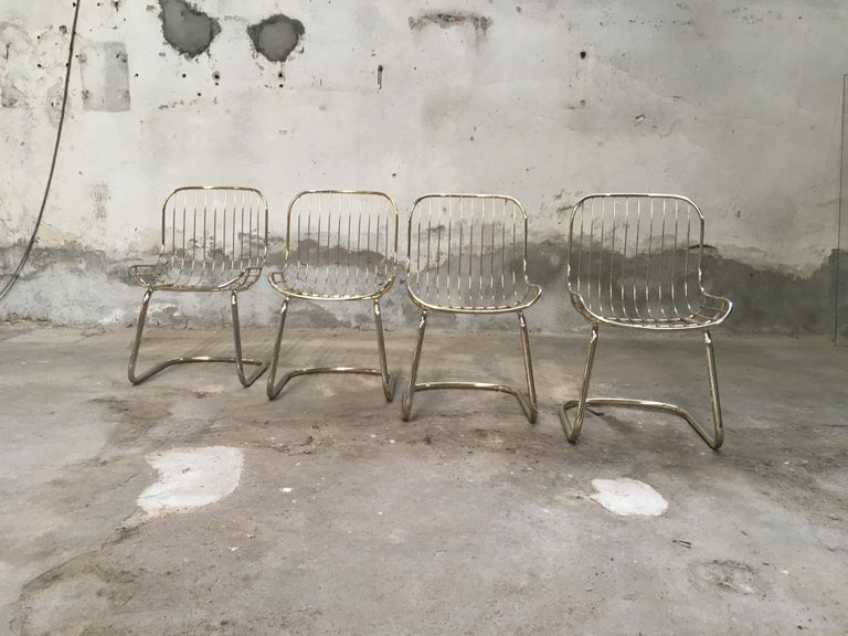 Mid-Century Modern Italian set of four gilt metal dining chairs from 1970s.