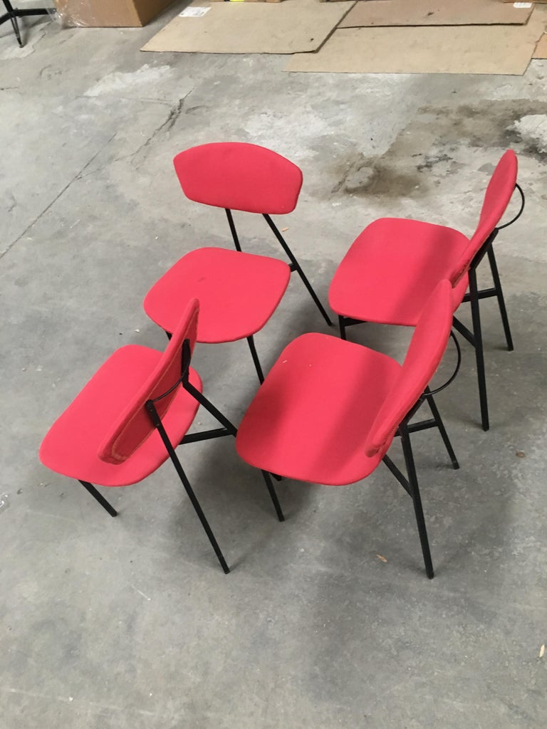 Mid-Century Modern Italian set of 4 dining or desk black lacquered iron chairs with its original red fabric upholstery, 1960s.