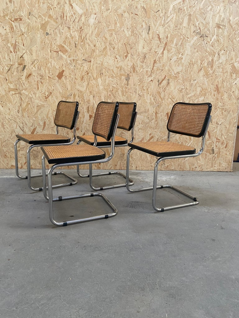 Set of 4 Marcel Breuer Cesca side chairs with black finish. Cane seats and backs. Classic chrome cantilever frames.