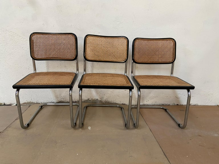 Mid-Century Modern Italian set of 3 chrome cantilever Cesca chair with black lacquered wood profiles by Marcel Breuer. The chairs are in really good vintage conditions.