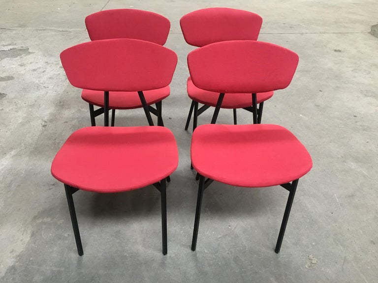 Mid-Century Modern Italian set of four dining or desk black iron chairs with original red upholstery, 1960s.