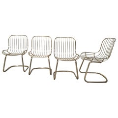 Mid-Century Modern Italian Set of Four Gilt Metal Dining Chairs. 1970s