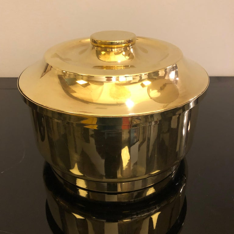 Round brass ice bucket made in Italy in the 1970s, item has been polished, inside the brass there is a glass useful to clean it. Item it's in very good conditions.