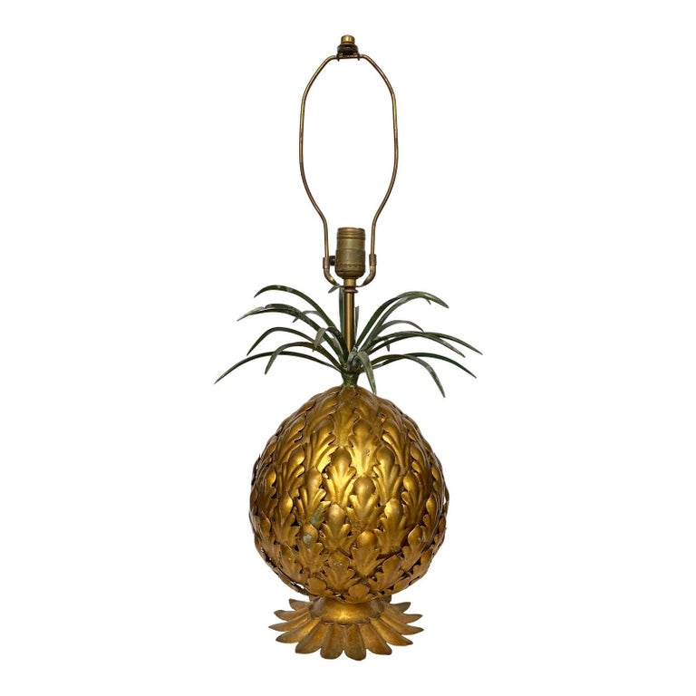 Gorgeous and unique sculptural Italian metal toleware pineapple table lamp. Body of lamp features welded metal fruit pieces in gold toned gilt finish. Metal slip leaves are nicely welded to the base of lamp. The top crown of the lamp features welded