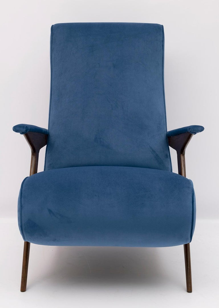 This particular Italian armchair, by an unknown designer, has been restored and upholstered in blue velvet. Armchair from the 1950s.