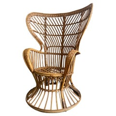 Mid-Century Modern Italian Wicker Wingback Armchair by Lio Carminati. 1950s