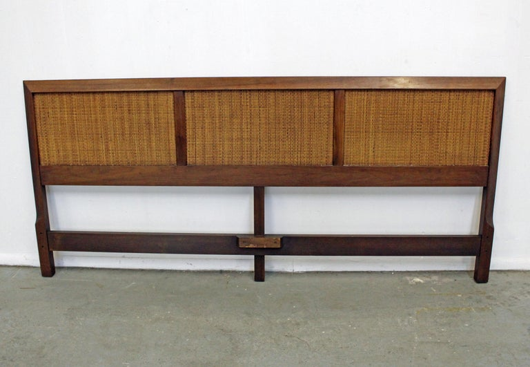 Offered is a vintage mid-century walnut and cane king-size headboard similar to the style of John Stuart. It is in good condition, shows slight age wear (surface scratches/chips-see pictures). It is not signed. See our other listings for more