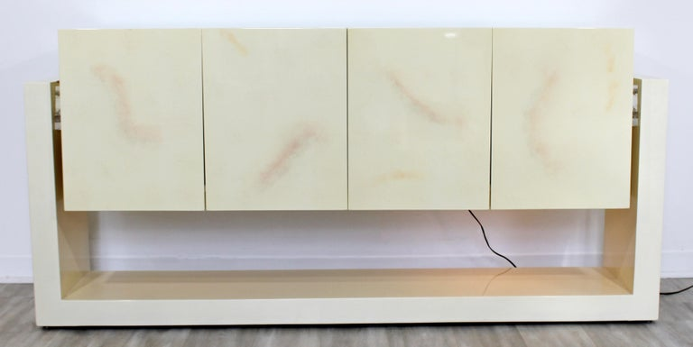 For your consideration is a luxe looking, light-up, Lucite and lacquer credenza, with two drawers and two shelves, in the Karl Springer style, circa 1970s. In excellent vintage condition. The dimensions are 71