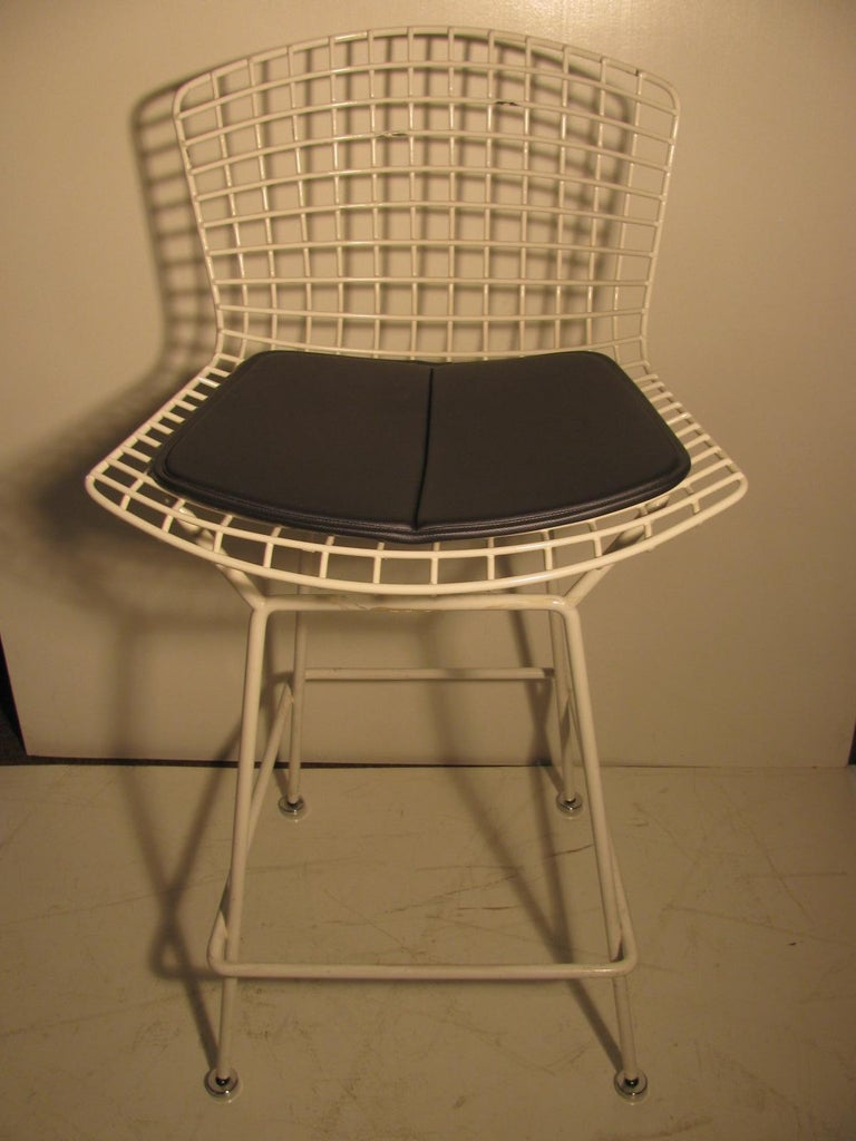 Single Knoll bar stool by Harry Bertoia. Seat pad labeled with tag and printed into the fabric Knoll. Has some loss to vinyl coating, pictured. Very tight and sturdy, will make a good addition to your set or use at a work station.