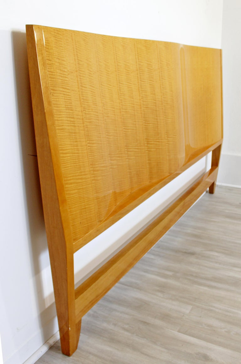 For your consideration is a gorgeous, lacquered maple, king sized headboard, with a stylized wave, circa 1970s. In excellent vintage condition. The dimensions are 79