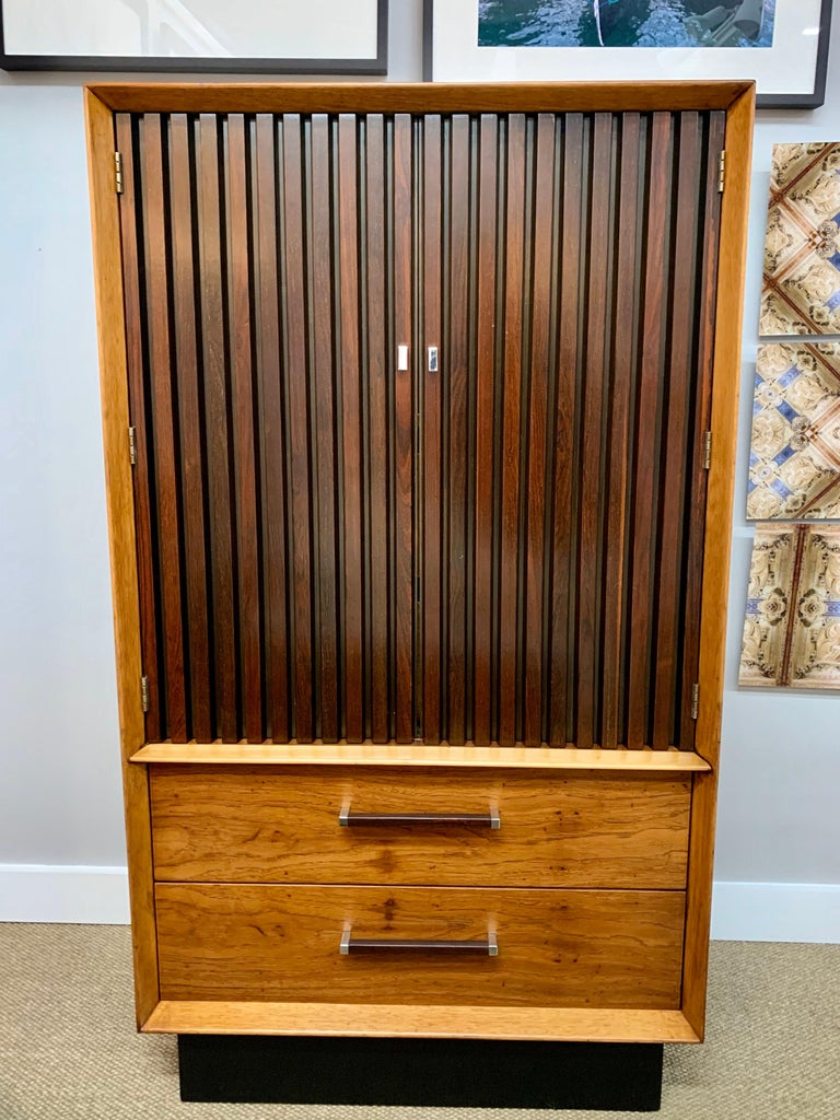 Elegant signed Lane Furniture wardrobe armoire. An iconic Brutalist cabinet with drawers at bottom and doors at top that open to show two drawers and them cubbies at the top part. The color scheme is quite unusual, even for Lane, with a black base