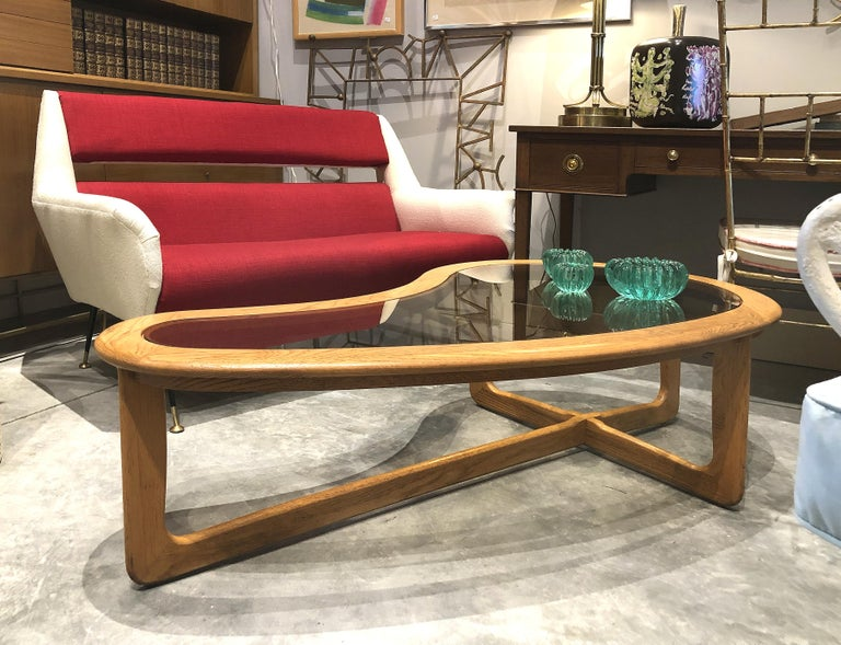 Mid-Century Modern Lane Kidney Shaped Boomerang Walnut and Glass Coffee Table  Offered for sale is a Mid-Century Modern vintage Lane kidney shaped boomerang walnut and glass coffee table. This 1960s sculptural coffee table is made by Lane Furniture