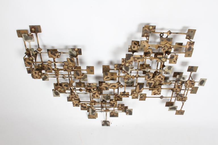 Artist Marc Weinstein Brutalist or Abstract wall sculpture from the early 1970s. This piece is constructed of flat panels in his hand burnish gold finish, in multiple layers and orientations. Marc creates (Textured dimensional sculptures). Over nice