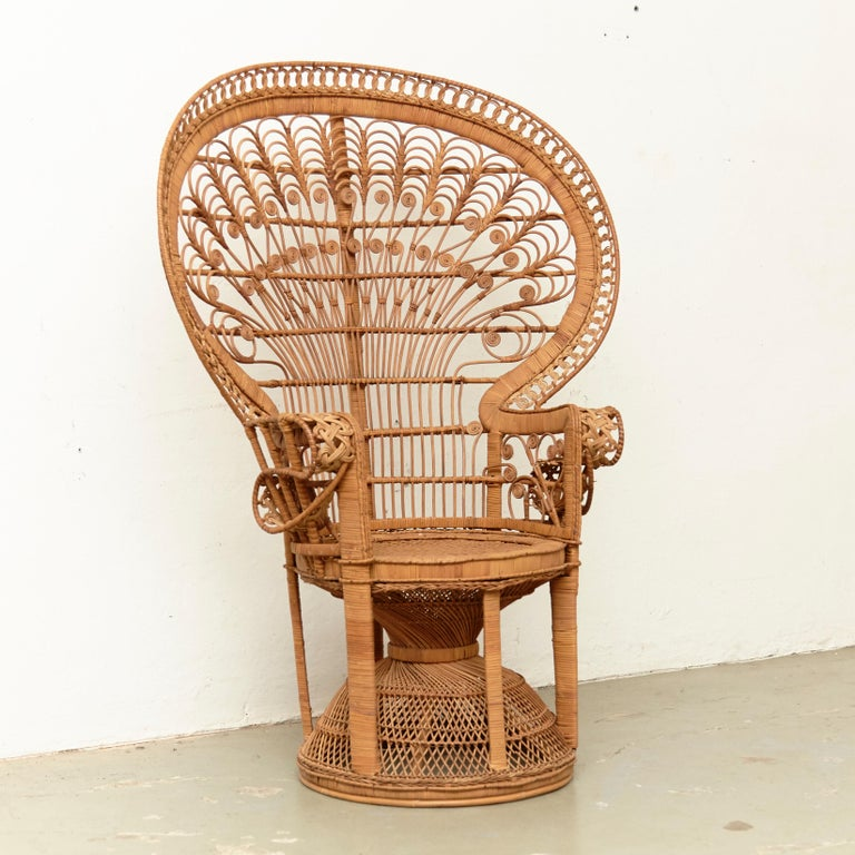 Mid-Century Modern Emmanuelle armchair rattan, circa 1960 Traditionally manufactured in France.  By unknown designer.  In original condition with minor wear consistent of age and use, preserving a beautiful patina.