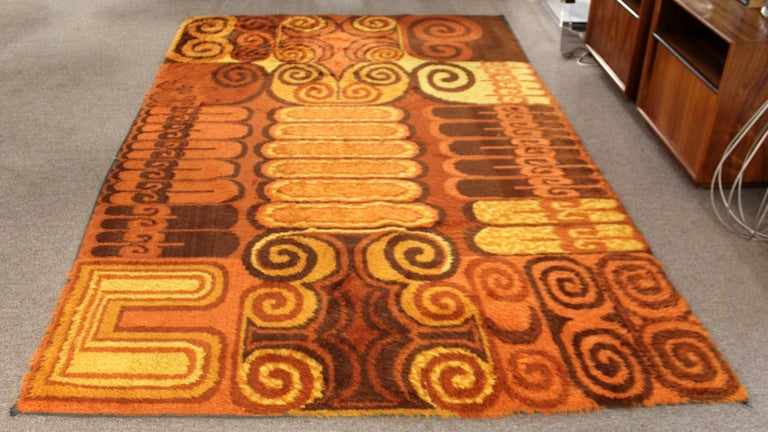 For your consideration is a fabulously groovy, orange patterned rya wool, shag rug, circa 1970s. In very good vintage condition. The dimensions are 71