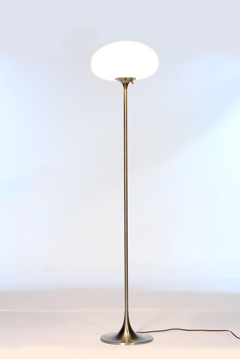 Authentic 1970s Laurel floor lamp with frosted glass mushroom globe and nickel finish. A few scratches and imperfections here and there and some pitting on base. Measures 56