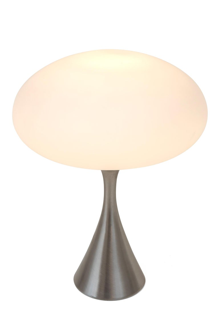 It doesn't get any more iconic than the Laurel Mushroom lamps. This particular lamp has the added appeal of the brushed steel base.