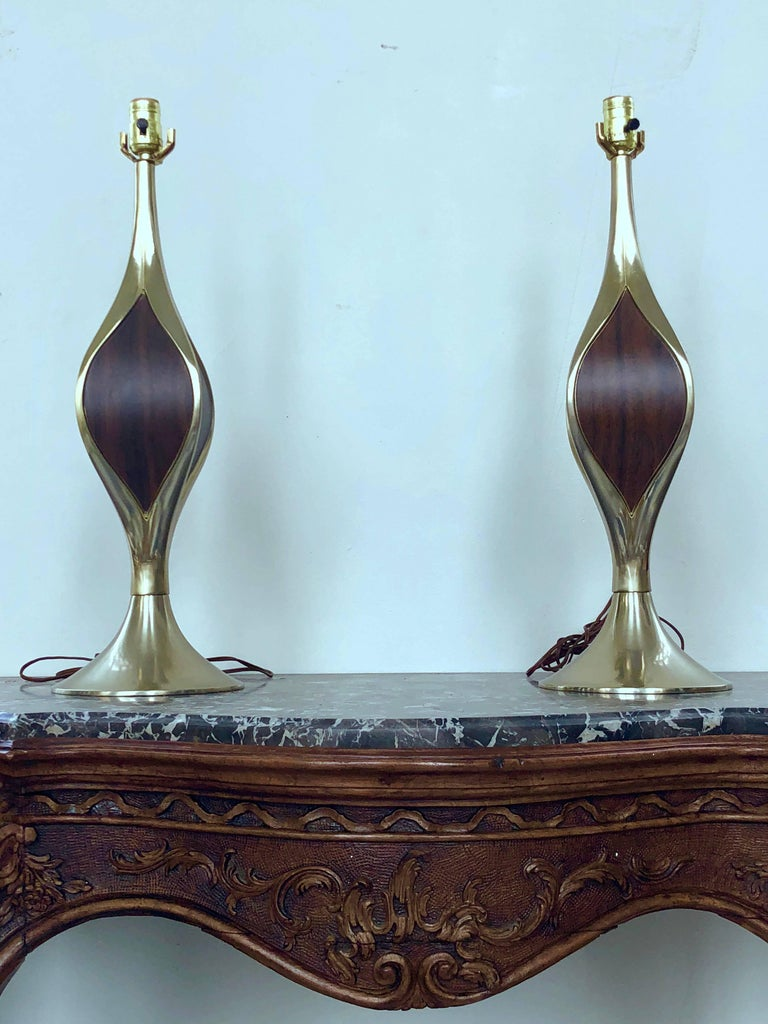 This beautiful pair of modernist Laurel Lamps is cast in solid brass, and inlaid with wood veneer accents on four sides. Made in the US.
