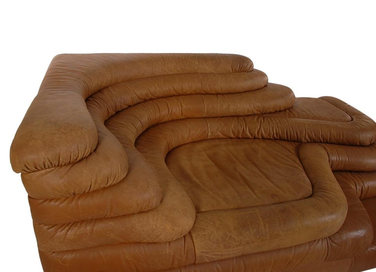 An uncommonly found leather chaise designed by Ubald Klug for De Sede in the 1960's. This