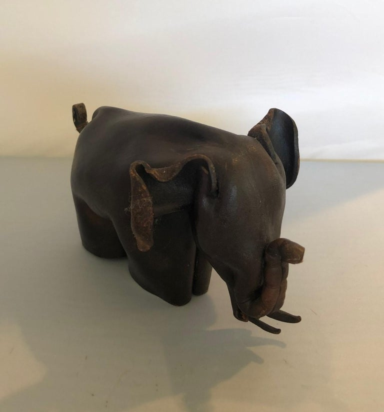 Rare Mid-Century Modern leather origami elephant sculpture, circa 1960s. The piece is made from one piece of leather that has been folded and manipulated to form an elephant. It is in the style of Deru and made in England (stamped on his right rear