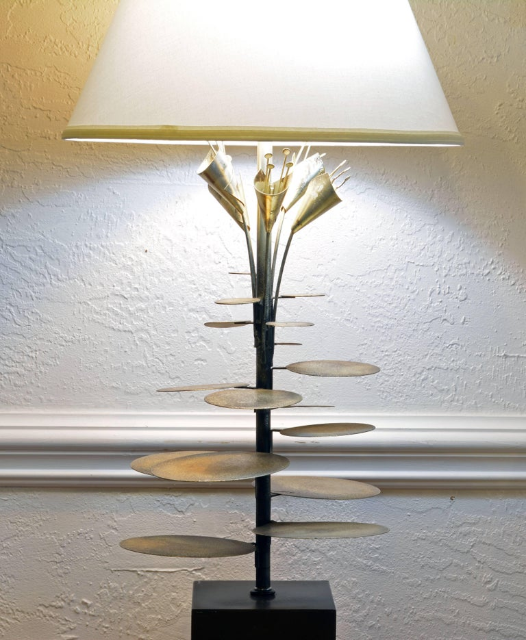 A wonderful likely custom-made lamp attributed to Curtis Jere featuring silver patinated stems and leaves rising from a square painted base and ending I stylized flowers. It includes a new pristine white shade. Height measurement below refer to the