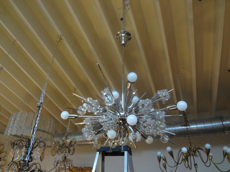 Mid-Century Modern Lobmeyr Metropolitan Opera exploding star chandelier, circa 1960s. This stunning iconic chandelier creates the effect of a starburst in handcut Austrian crystals. This Sputnik chrome and glass chandelier was designed in the 1960s