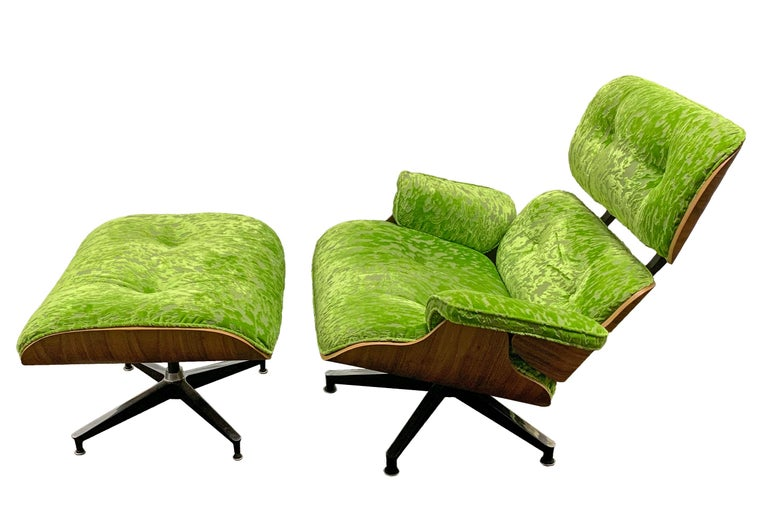 Mid-Century Modern lounge chair and ottoman in style of Charles and Ray Eames. Recently refurbished and reupholstered in Designers Guild-UK fabric.