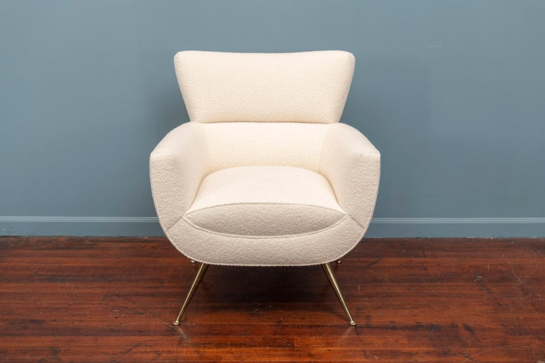 Mid-Century Modern lounge chair by Henry Glass, newly upholstered in cream bouclé fabric on tapering brass legs.