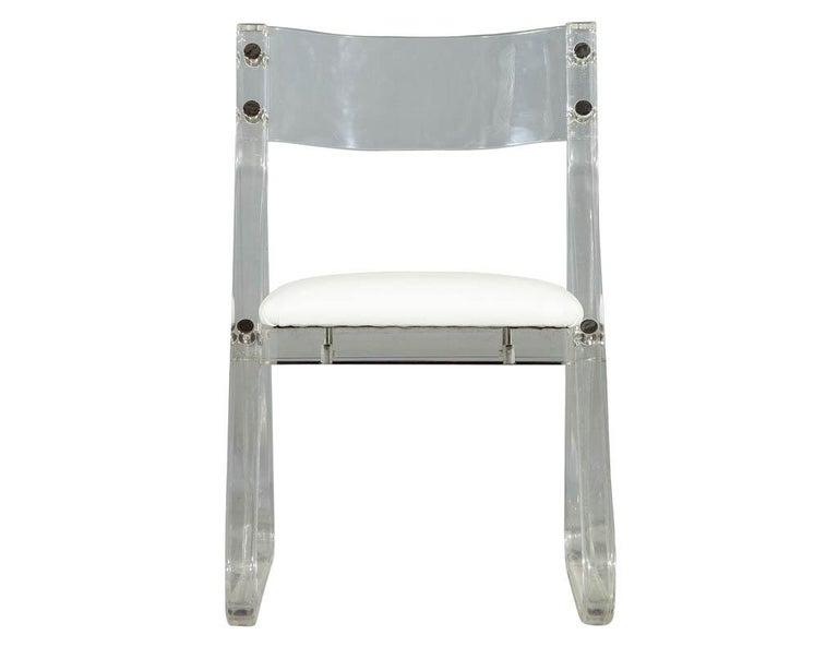 Vintage Lucite acrylic side chair with triangle base frame and slightly curved back. Upholstered seat and chrome button fittings on joints. Perfect for a desk or vanity setting.