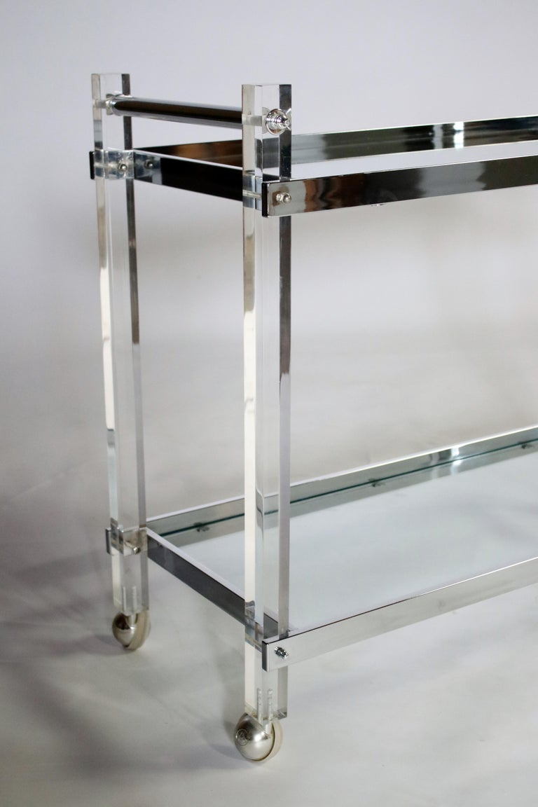 1970s chrome and glass and mirror rolling bar cart on castors.