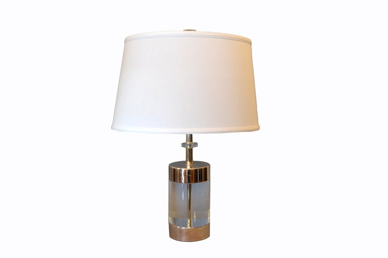 Mid-Century Modern Lucite and nickel table lamp. It is in perfect working condition and uses a max. 60 watts light bulb. Comes with harp and finial, but no shade. The Lucite is very thick and the lamp is heavy. Dimensions: Height to top: 29