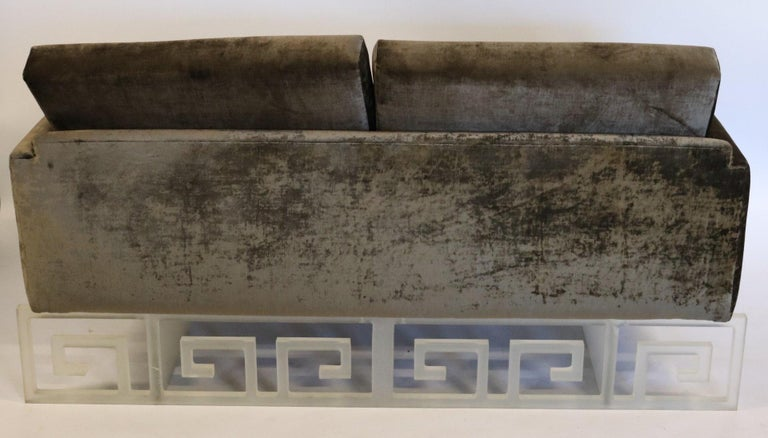 Bespoke loveseat upholstered in a gunmetal crushed velvet and supported by a frosted Lucite base with Greek key pattern on the front and back. Beautiful one-of-a-kind piece!