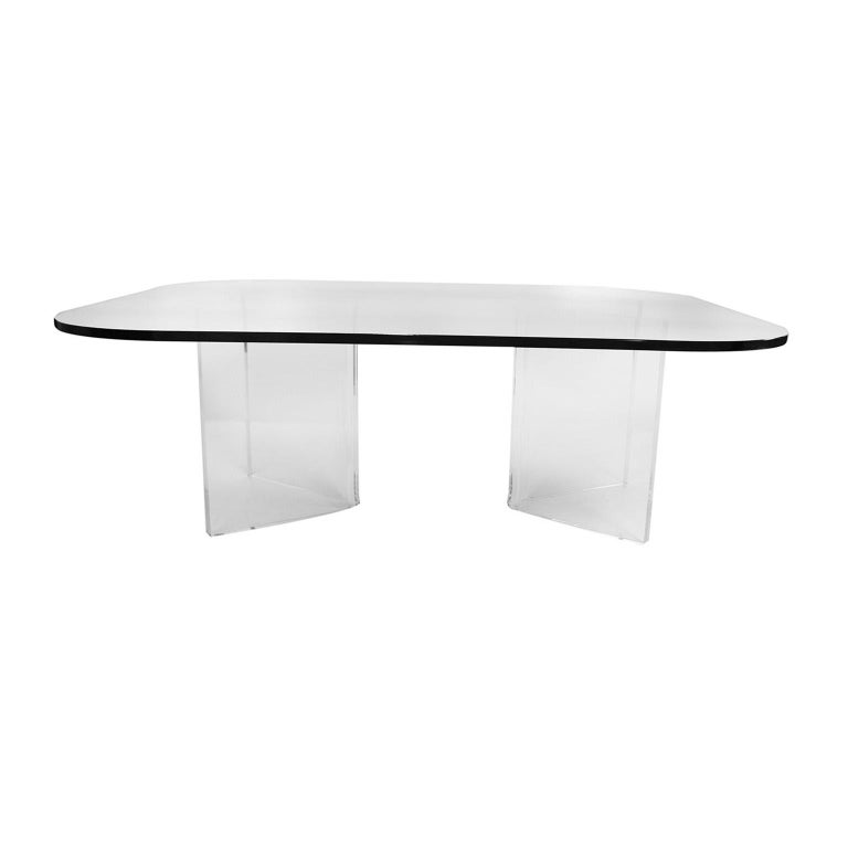 """An elegant, stylish midcentury rectangular rounded corners glass top, with Lucite base coffee table. Features a unique two piece """"V"""" shaped Lucite base supporting 1/2? thick glass rectangular top with radius corners. Table has two movable"""