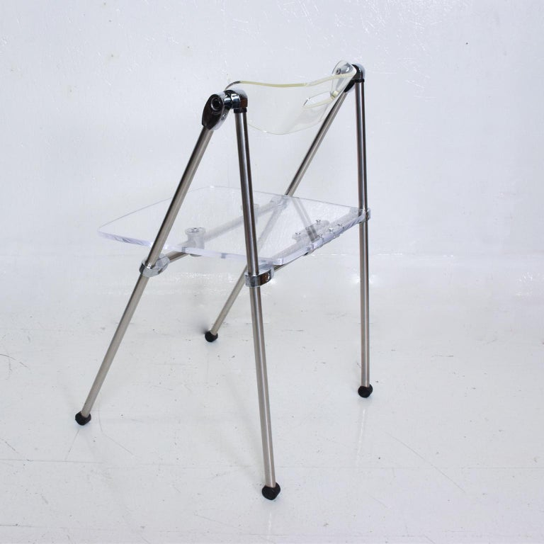 For your consideration, a single occasional Lucite Chair, After Giancarlo Piretti, Castelli. The Original seat was replaced with a new lucite seat and aluminum support. Backrest has a stress fracture. Refer to images. No label present from the